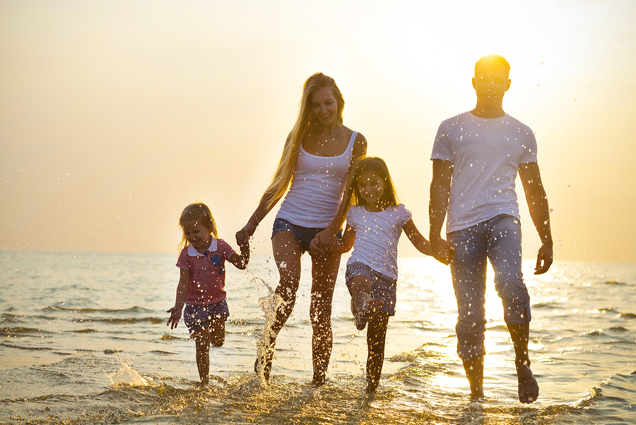 Happy family playing at sunset